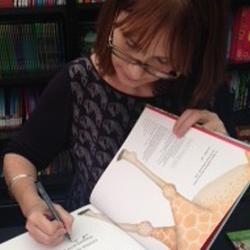 Jane Ray Children's Illustrator signing her book