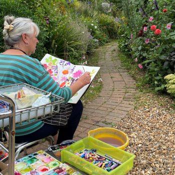 Tessa Pearson painting in her Surrey garden